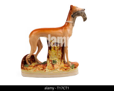Staffordshire pottery standing greyhound with hare in it's mouth.  This are probably a reproduction. - Stock Photo