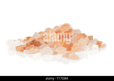 Lot of pieces of pink himalayan salt crystals stack isolated on white background - Stock Photo