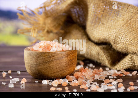 Lot of pieces of mineral pink himalayan salt crystals in the mountains - Stock Photo
