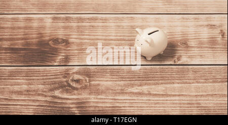 white piggy bank on wooden background.Investment concept - Stock Photo