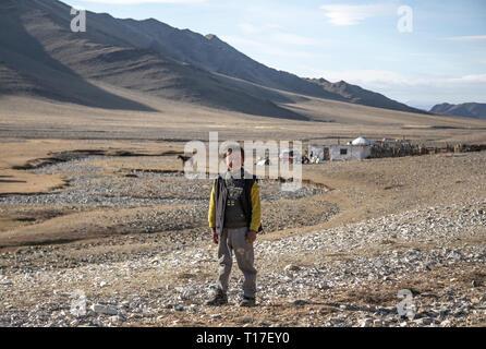 bayan Ulgii, Mongolia, 30th September 2015: mongolian kazakh nomad boy outside his home in Western Mongolia - Stock Photo