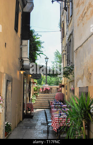 Cozy old street in Trastevere in Rome, Italy. Trastevere is rione of Rome, on the west bank of the Tiber in Rome, Lazio, Italy. Architecture and landm - Stock Photo