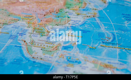 Philippines, Cambodia, Vietnam in close up on the map. Focus on the name of country. Vignetting effect. - Stock Photo