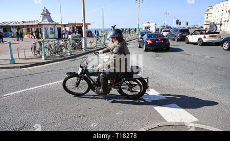 Brighton, UK. 24th March 2019. An entrant leans into the final corner on Brighton seafront in the 80th Anniversary Pioneer Run for pre 2015 veteran motorcycles . The run organised by the Sunbeam Motor Cycle Club begins on the Epsom Downs in Surrey and finishes on Madeira Drive on Brighton seafront Credit: Simon Dack/Alamy Live News - Stock Photo
