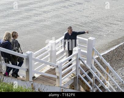 Sidmouth, UK. 24th Mar, 2019. The view from Jacob's Ladder on the beach at Sidmouth proves popular on a sunny day in March. Credit: Photo Central/Alamy Live News - Stock Photo