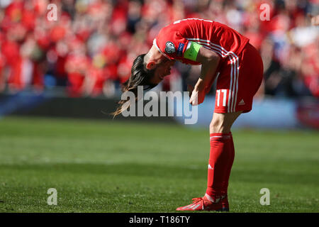Cardiff, Wales, UK. 24th Mar 2019. Gareth Bale of Wales adjusts his long hair during the game.  UEFA Euro 2020 qualifier match, group E, Wales v Slovakia at the Cardiff city Stadium in Cardiff , South Wales on Sunday 24th March 2019. pic by Andrew Orchard /Andrew Orchard sports photography/Alamy live News EDITORIAL USE ONLY Credit: Andrew Orchard sports photography/Alamy Live News - Stock Photo