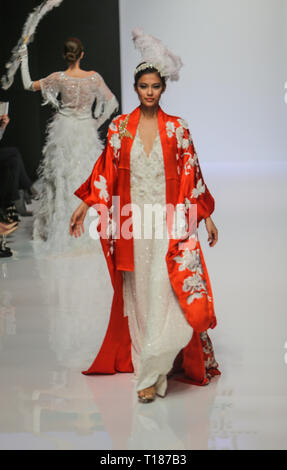 London, UK. 24th Mar 2019. Celebrating its 10th year, White Gallery ,collection byJane Howell  with Cabaret Theme cutover the audience with their colours the dance and the wonderful designs Credit: Paul Quezada-Neiman/Alamy Live News - Stock Photo