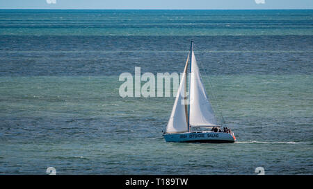 Bray Head, Ireland. 24th March, 2019 Sailing boat making his way in the sea. Credit: Vitaliy Tuzov/Alamy Live News - Stock Photo