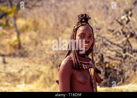 Young himba woman near the Epupa Falls in Namibia - Stock Photo