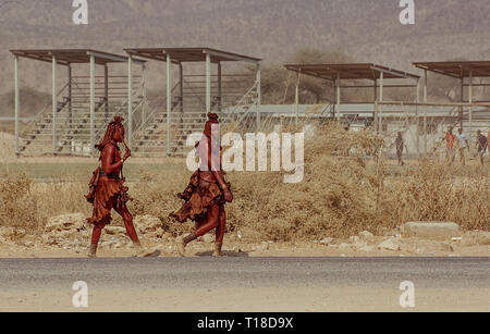 Pair of young himba women in Opuwo in Namibia - Stock Photo