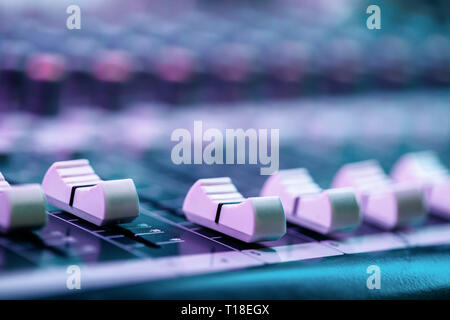 Close up of fader's on sound mixing console. Details of sound engineer room. - Stock Photo
