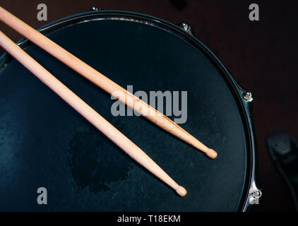 Drumsticks on a black snare background. Beautiful drumsticks. Music, concert concept. - Stock Photo