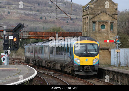 Class 185 Desiro diesel multiple unit in TransPennine express livery arriving at Carnforth with a Northern service to Manchester Airport, 21-03-2019. - Stock Photo