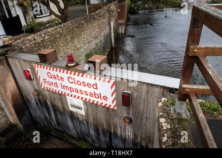 Sign - gate closed, ford impassable, on the river Sid, at Sidmouth, Devon, UK - Stock Photo