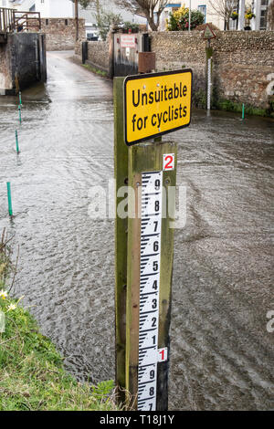 Sign - unsuitable for cyclists, at a ford crossing of the river Sid, in Sidmouth, Devon. - Stock Photo