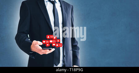 social media notification, man holding mobile phone, businessman using smartphone - Stock Photo
