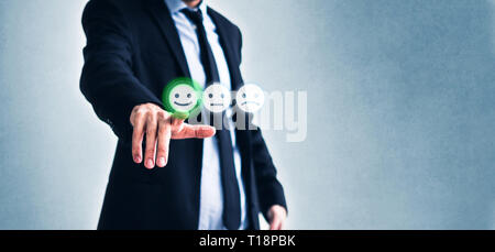 costumer review concept, man rating service by clicking  on happy smiling face  symbol - Stock Photo