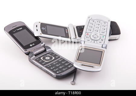 Old Classic Flip Style Cell Phones on White - Stock Photo