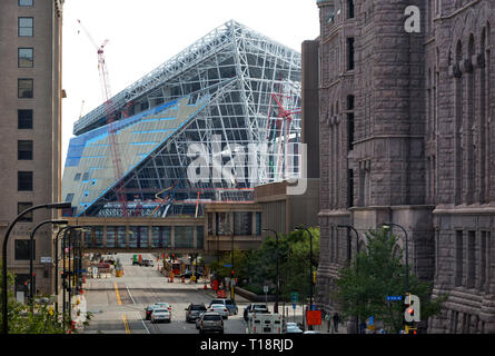 Looking east down 4th Street South at the building construction of U.S. Bank Stadium, future home of the NFL football team the Minnesota Vikings in Mi - Stock Photo