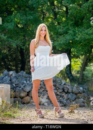Teenager teenage girl legs heels standing posing in nature - Stock Photo