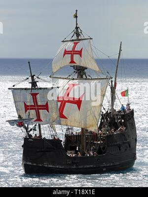 Replica ot vessel Santa Maria is passing the port of Funchal - Stock Photo