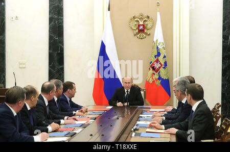 Russian President Vladimir Putin chairs a meeting the Security Council at the Kremlin March 22, 2019 in Moscow, Russia. - Stock Photo