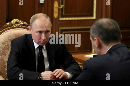Russian President Vladimir Putin during a working meeting with Acting Governor the Orenburg Region Denis Pasler at the Kremlin March 21, 2019 in Moscow, Russia. - Stock Photo