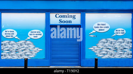 Funny advertisement for a new fishmongers fish restaurant depicting fish talking about the coming soon store opening in Killarney County Kerry Ireland - Stock Photo