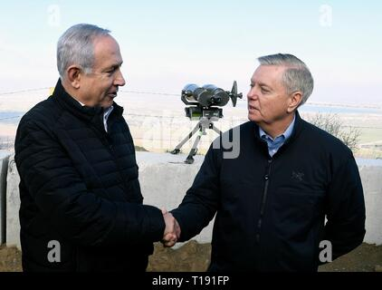 Israeli Prime Minister Benjamin Netanyahu, left, shakes hands with U.S. Senator Lindsey Graham of South Carolina at a lookout point on the Israeli-occupied Golan Heights March 11, 2019 in Golan, Israel. - Stock Photo