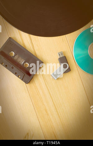 Vintage Look Music Recording Evolution with Cassette USB Key, Vinyl record and CD - Stock Photo