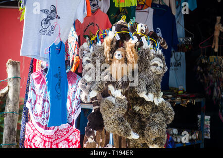Souvenirs for sale in Manuel Antonio National Park entrance in Costa Rica - Stock Photo