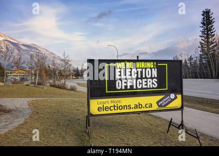 Roadside Hiring Sign next to Elevation Place Recreation Centre in Town of Canmore for upcoming Alberta Provincial Elections in month of April 2019 - Stock Photo