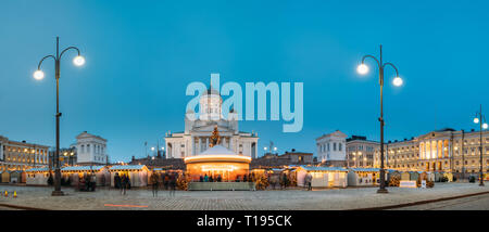 Helsinki, Finland - December 11, 2016: Christmas Market On Senate Square With Holiday Carousel And Famous Landmark Is Lutheran Cathedral In Winter Nig - Stock Photo