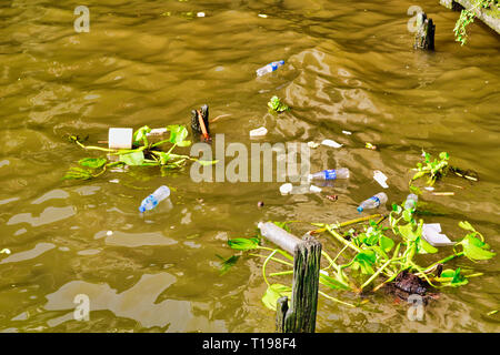 This unique photo shows how the water is polluted with plastic garbage in the bangkok river Mae Nam Chao Phraya - Stock Photo