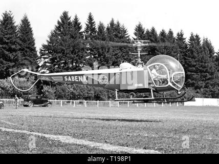 mail, airmail, helicopter Bell 47 D in the postal service of the Sabena, landing on a sports field, Belgium, 1950, Additional-Rights-Clearance-Info-Not-Available - Stock Photo