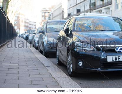 File photo dated 16/01/16 of cars parked on a residential street in London. Nearly two thirds of teachers would support car-free roads outside schools during drop-off and pick-up times, a survey suggests. - Stock Photo