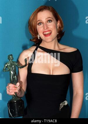 LOS ANGELES, CA. February 23, 1997: X-Files star GILLIAN ANDERSON with her Screen Actors Guild Award for Favorite Actress in a TV Dramatic Series. Pix: PAUL SMITH - Stock Photo
