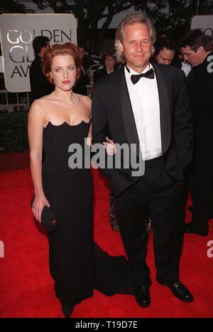 LOS ANGELES, CA - January 18, 1998: Actress GILLIAN ANDERSON & 'X-Files' creator CHRIS CARTER at the Golden Globe Awards. - Stock Photo