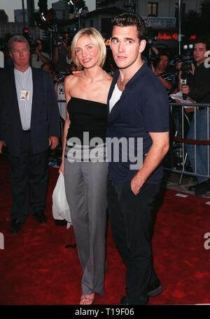 LOS ANGELES, CA - July 9, 1998: Actress CAMERON DIAZ & boyfriend & co-star MATT DILLON at the world premiere, in Los Angeles, of their new movie 'There's Something About Mary.' - Stock Photo