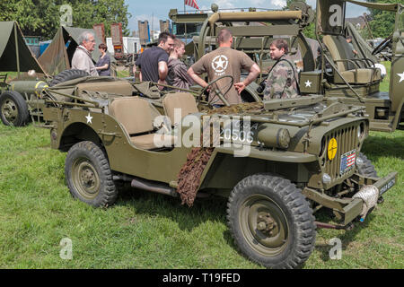 A Willys MB jeep, part of the D-Day 70th Anniversary events, re-enactors and vehicle displays in Sainte-Mère-Église, Normandy, France in June 2014. - Stock Photo