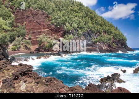 Red Sand Beach in Hana on Maui. - Stock Photo