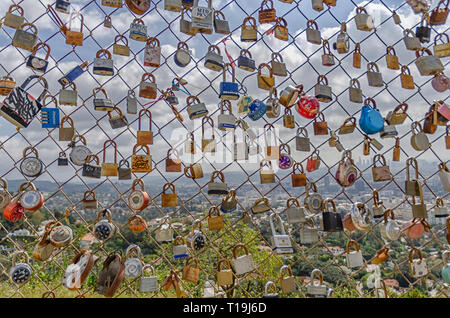 Los Angeles, CA, USA, March 22, 2019: Close-up of Love locks on a fence in Runyon Canyon, Los Angeles, CA. The padlocks signify people's love. - Stock Photo