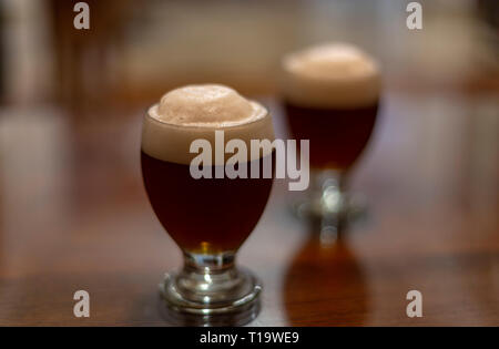 Two glasses full of craft beer - Stock Photo