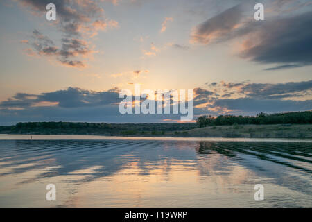 View of Sun Behind Dark Clouds Over Georgetown Lake - Stock Photo