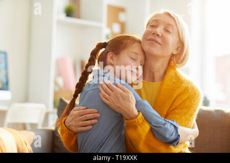 Mother and Daughter Embracing Tenderly - Stock Photo