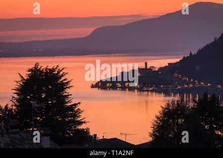 Lake Iseo with the town of Peschiera Maraglio on Monte Isola at dusk, Lombardy, Italy - Stock Photo
