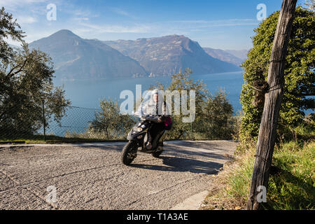 Scooter rider on Monte Isola, Lake Iseo, Lombardy, Italy - Stock Photo