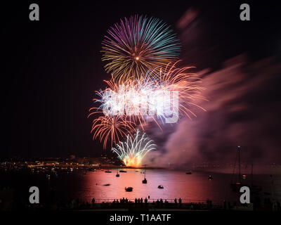 A firework going off at the National Firework Championships on Mount Batten. - Stock Photo