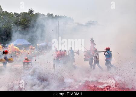 GAOZHOU, CHINA – CIRCA MARCH 2019: Nian Li a unique traditional festival is full of folk cultural customs - lion and dragon dance, fire crackers... - Stock Photo