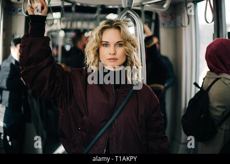 Photo of curly blonde riding in bus. - Stock Photo